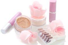 Makeup set. With soap roses, lipsticks, powder, sticks of eye shadows Royalty Free Stock Images
