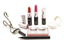 Makeup set with lipstick false lashes eyelash curler and  eyesha Stock Photos