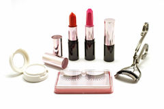 Makeup set with lipstick false lashes eyelash curler and  eyesha Royalty Free Stock Photo