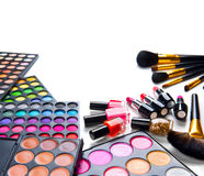 Makeup set palettes with colorful eyeshadows. Cosmetic brushes Stock Image