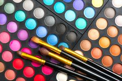 Makeup set. Professional multicolor make up eyeshadows palette and brushes stock photography