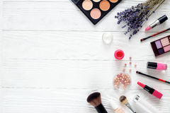Makeup set on wooden table with lavender top view stock photos