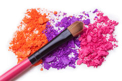 Makeup shadows and brush Stock Images