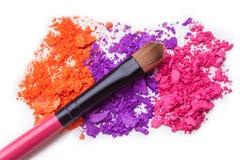 Makeup shadows and brush. Makeup brush eye shadows colours  art makeup artist white orange pink  art blending soft Stock Images