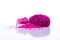 Makeup shadows powder. Jar with vivid makeup shadows and pile of pink powder with fuzy applicator Stock Photography