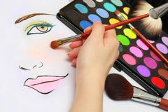 Makeup Sketching. Makeup artist is sketching makeup style on a paper Royalty Free Stock Photo