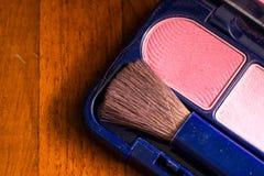 makeup tła koloru prochowi kosmetyki przyglądają się twarzy muśnięcia piękno Fotografia Royalty Free