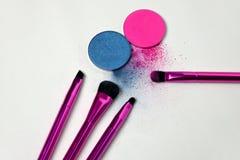 Makeup tools. Makeup brushes with eye shadows Stock Photos