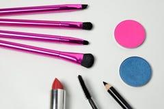 Makeup tools. Makeup brushes with eye shadows, mascara, lipstick and eyeliner Royalty Free Stock Image