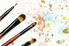 Makeup tools and materials. Eyeshadows and brushes on white background Royalty Free Stock Image