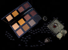 Makeup tools & Silver Accessories on Fur black background Stock Image