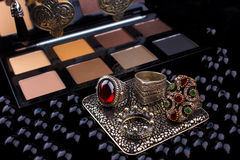 Makeup tools & Silver Accessories on Fur black background Royalty Free Stock Photography