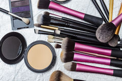 Makeup tools. On a silver background Royalty Free Stock Photo