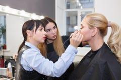Makeup tutorial lesson at beauty school. Makeup teacher with her student girl. Makeup tutorial lesson at beauty school. Make up artist work in her studio stock photo