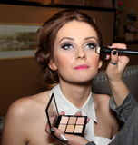 Makeup before wedding. Girl getting makeup applied before wedding Stock Photography