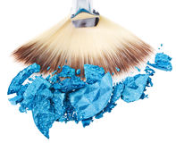 Makeup wide brush with blue crushed eye shadow Royalty Free Stock Photos