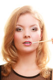 Makeup. Woman applying red lipstick with brush Royalty Free Stock Photo