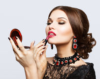 Makeup of young beautiful brunette woman in black dress with lip Stock Photo