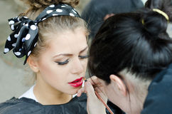 Makeup young model. Makeup artist, makeup young female model Royalty Free Stock Image