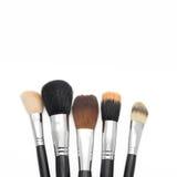 Makeupborstar för framsida på vit bakgrund Arkivfoto
