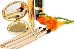 Makeups da mola em dourado Fotografia de Stock