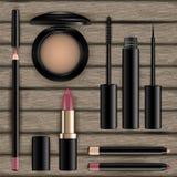 Makeupskönhetsmedel ställde in på träbakgrund Ögonskugga, eyeliner, G stock illustrationer