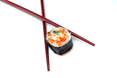 Maki with chopsticks  Stock Image
