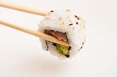 Maki on chopsticks Stock Photo