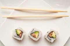 Maki and chopsticks Royalty Free Stock Photo
