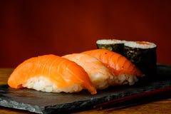 Maki and nigiri sushi. Still life with traditional homemade maki and nigiri sushi royalty free stock photography