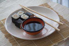 Maki with perch on stкaw matt. Plate of tasty japanese maki rolls, Copy space for text stock photo