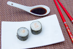 Maki with prawns on bamboo seen up close Stock Images