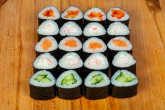 Maki roll set. Salmon, crab, cucumber royalty free stock photo