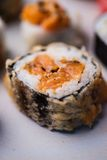 Maki roll with tempura and salmon Royalty Free Stock Photos