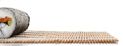 Maki round on a mat seen frontally. On a white background stock image