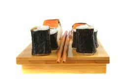 Maki and sashimi sushi on plate Stock Images