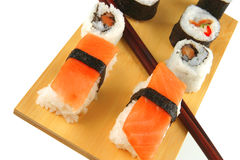 Maki and sashimi sushi on plate Royalty Free Stock Photos
