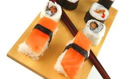 Maki and sashimi sushi on plate Royalty Free Stock Images