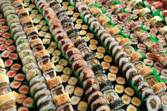 Maki sushi. Photo of fresh maki sushi platter with a lot of variety. Selective focus on middle of the platter royalty free stock photos