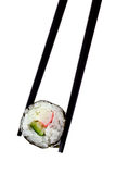 Maki sushi. Chopsticks holding maki sushi isolated on white background Stock Image