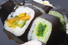 Maki sushi. With cucumber (on the black plate Royalty Free Stock Image