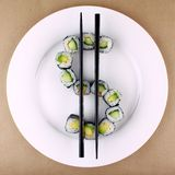 Sushi as dollar sign on white plate, closeup Stock Photo