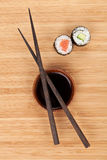 Maki sushi, chopsticks and soy sauce Stock Photo