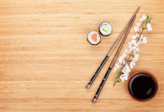 Maki sushi, chopsticks and soy sauce Royalty Free Stock Images
