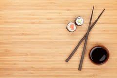 Maki sushi, chopsticks and soy sauce Stock Photos