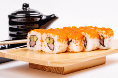 Maki Sushi made of Salmon, Red caviar, cucumber, avocado and cre Royalty Free Stock Photo
