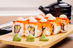 Maki Sushi made of Salmon, Red caviar, cucumber, avocado and cre Royalty Free Stock Photos