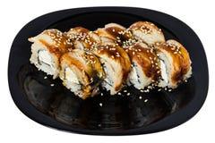 Maki sushi med den rökta ellen. Arkivfoton