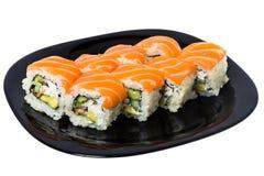Maki sushi med laxen. Royaltyfria Bilder