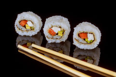Maki sushi over black background sashimi sush Stock Photos